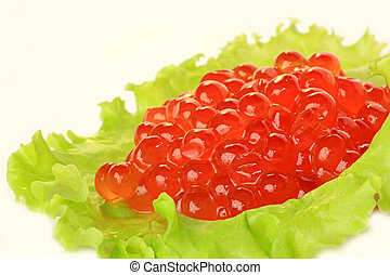Red caviar. - Red caviar and green lettuce.