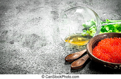 Red caviar with a glass of white wine.