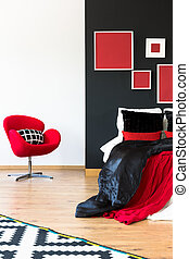 Red chair against white wall