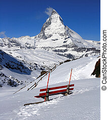 Red chair and Matterhorn, logo of Toblerone chocolate,...
