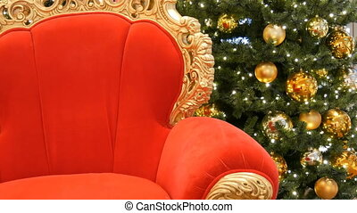 Red chair of Santa Claus or St. Nicholas near christmas tree...