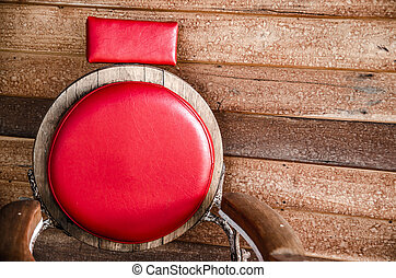 red chair on wood background