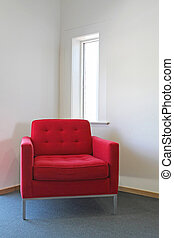 Red Chair - A red chair on blue carpet and white walls