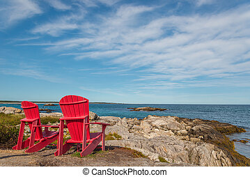 Red chairs facing Keji Seaside beach (South Shore, Nova...