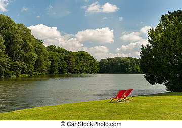Red chairs in a park