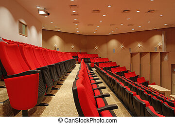 Red chairs in theatre
