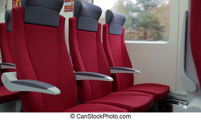 Red chairs in train.