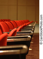 Red Chairs - A line of red theatre chairs - short depth of...