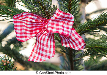 red checked bow at a christmas tree