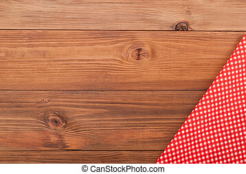 Red checkered cloth on a wooden table.