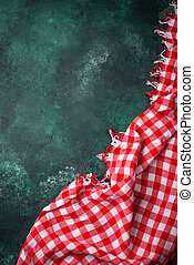 Red checkered tablecloth on green background