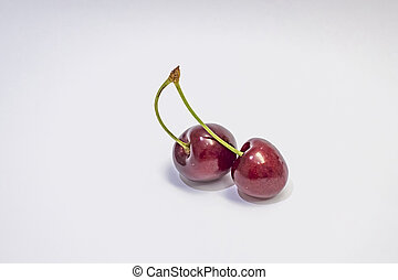 red cherries on a white background