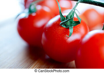Red cherry tomatoes on a cutting