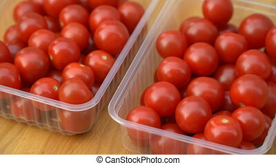 red cherry tomatoes rotating on a plate.