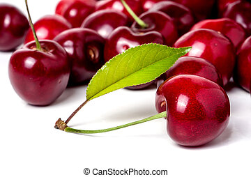 red cherry with leaf isolated on white background