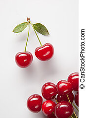 Red cherry with leaves on white