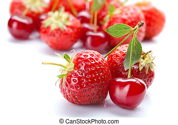 Red cherry with strawberry on white