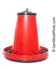 red chicken feeder in front of white background