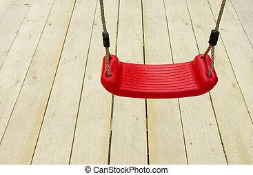 Red children\'s swing