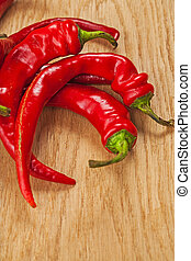 red chili pepers on wooden board