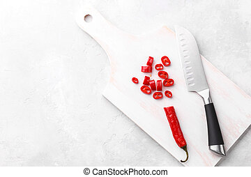 Red chili pepper on cutting board