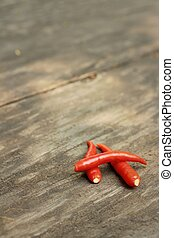 Red chilies on a background of wooden
