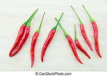 red chilies on wood background