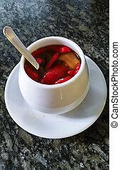 Red chilli pepper in a white pot