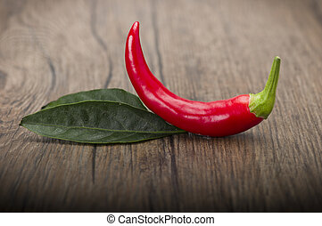 Red Chilly pepper - Red chili pepper isolated on a wood...