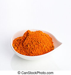 red chilly powder in white bowl - isolated on white - red...