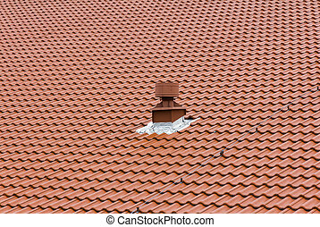 red chimney on the roof composed of red tiles