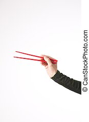 red chopsticks in woman arm