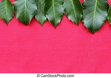 Red Christmas background with holy leaves