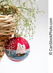 red christmas ball and basket