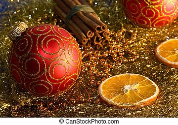 red christmas ball, cinnamon, orange and beads