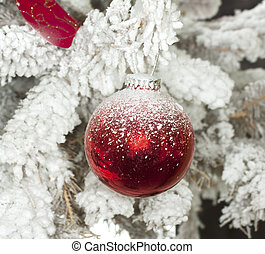 Christmas ball - Red Christmas ball in a white Christmas...