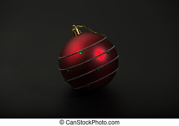 red christmas ball on black background