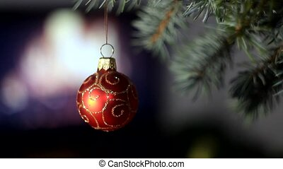 Red Christmas ball on christmas tree
