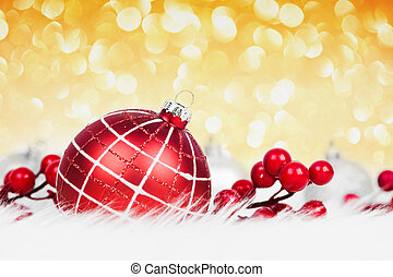 Red christmas ball on glitter background