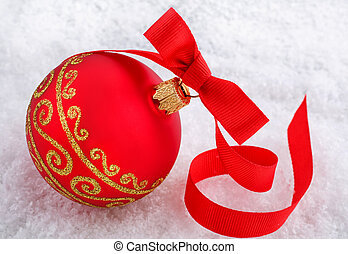 Red Christmas ball with ornament on snow