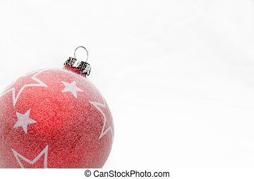 red christmas ball with white stars in the lower left corner