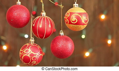 red Christmas balls hanging on strings