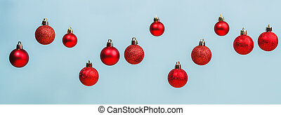 Red Christmas balls on a blue background
