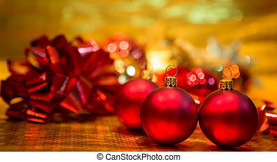 Red Christmas balls on a gold background