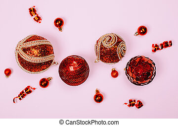 Red christmas balls on pink pastel background.