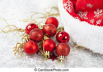Red Christmas balls on sparkling silver background