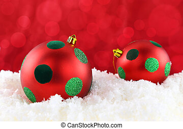 Red Christmas balls on the snow
