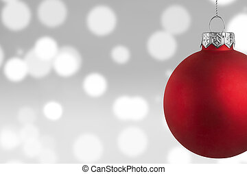 Red Christmas bauble over bokeh background