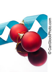Christmas baubles and a blue ribbon