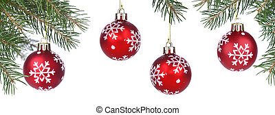 red christmas baubles hanging on branch of a tree fir on white background